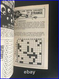 STRANGE N° 60 E. O LUG 1975 POSTER attaché Encarté